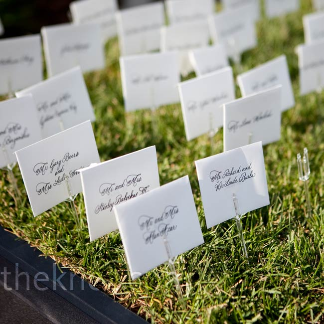 The calligraphed escort cards looked as if they were growing in a bed of grass.