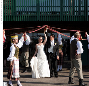 Nina and Anson included a Lithuanian folk dance, in which dancers held colored sashes to form a tunnel as guests entered the tent.