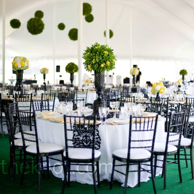 Tall topiary centerpieces and hanging pomanders of moss decorated the tent.