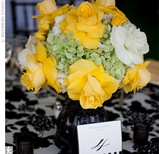 Lush, low arrangements of yellow and white roses and green hydrangeas popped on the black-and-white tables.