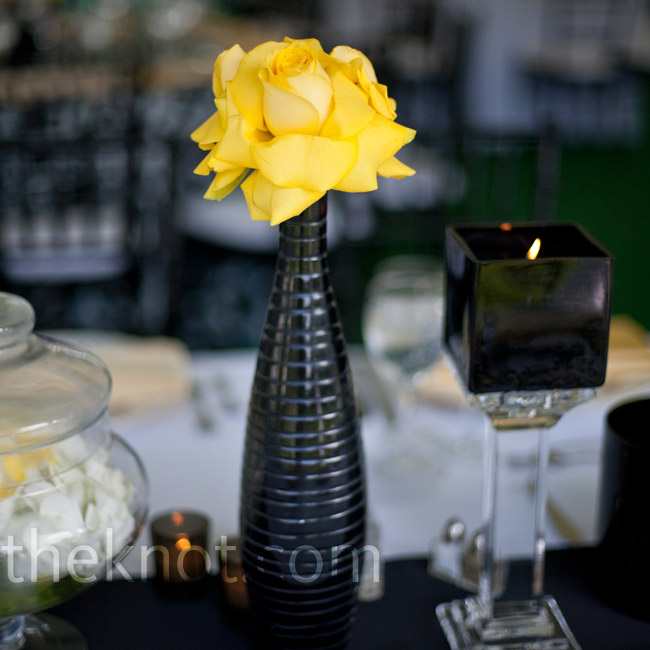 For a garden-chic look, black Waterford crystal vases, mod votives and flowers topped the tables.