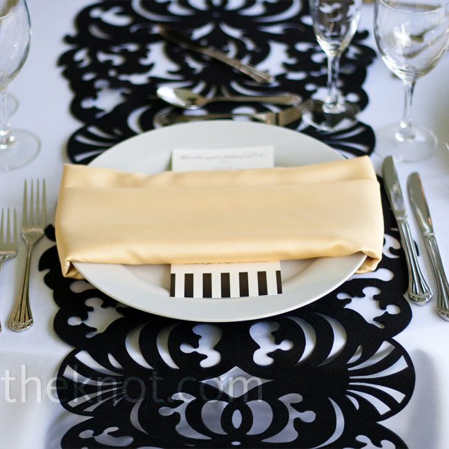 Simple napkins and menu cards let the decorative table runners stand out.