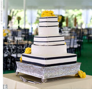Black and white fondant stripes and yellow flowers decorated the cake's round and square tiers.