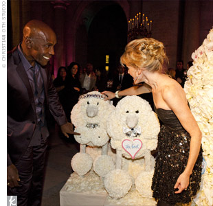 Known for his signature animal sculptures, Preston topped off the Bride in Bloom installation with two complementary poodles made of white carnations and dusty miller.Photo: Christian Oth Studio