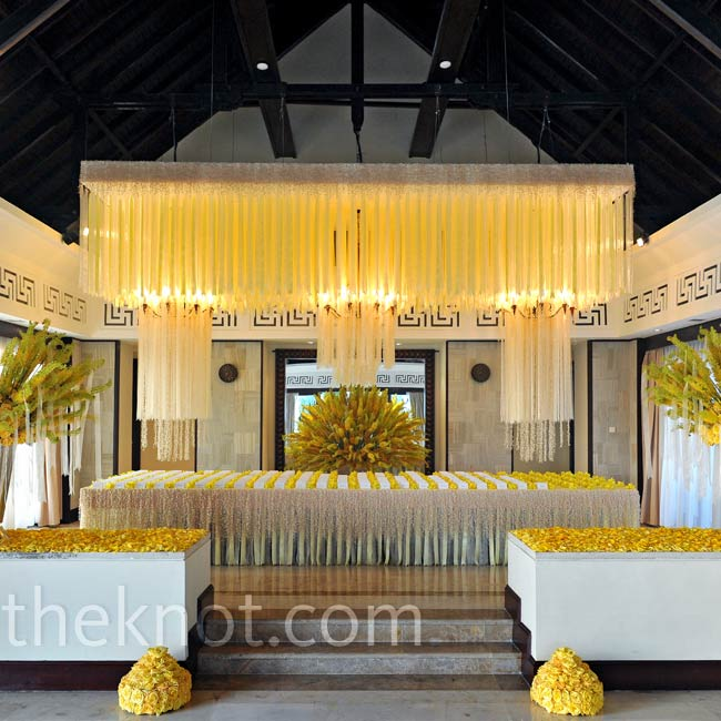 Preston recommends capturing the guests' attention right away with a striking escort card display, like this alcove entrance accented with yellow roses.Photo: John Labbe