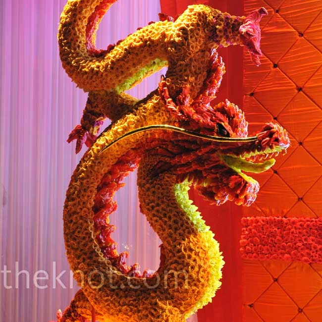 "Never one to shy away from color, Preston prides himself in executing vivid motifs without sacrificing class, like with this floral dragon installation. ""Color is a very powerful element, and it changes from culture to culture and bride to bride,"" he explains. ""The beauty of taking different cultures and translating them into colors that are import ..."