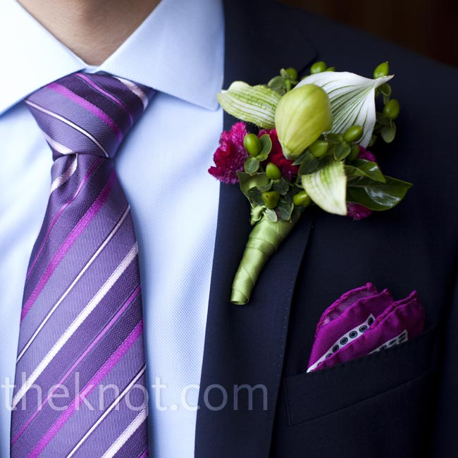 For a pop of color against his navy suit (and to match his bright tie and pocket square), Thomas wore a magenta and green boutonniere of a single lady's slipper orchid, berries and celosia.