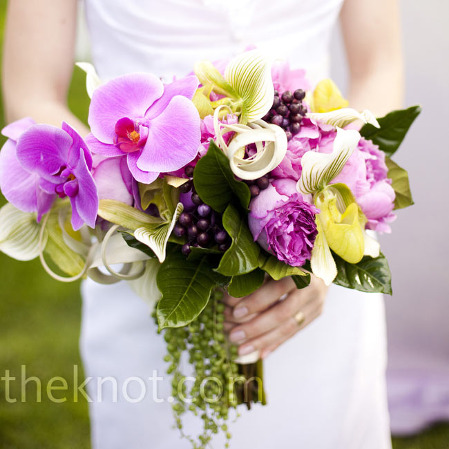 Corina's one floral request: nothing too traditional. Her bouquet was an asymmetrical mix of peonies, orchids, and purple and green berries.