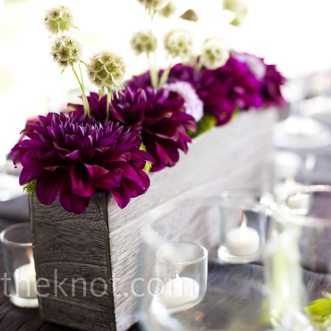 To accompany the centerpieces suspended from the tent, low arrangements topped the tables. The scabiosa and lotus pods gave them an exotic look.