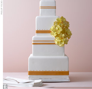 It's the shape that gives this simple banded cake with orchid sugar flowers a fresh look and feel.