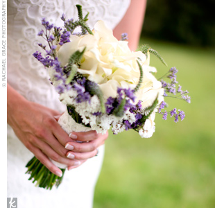 Adrienne carried a hand-tied bouquet of white calla lilies collared with white and purple statice, caspia and Veronica.