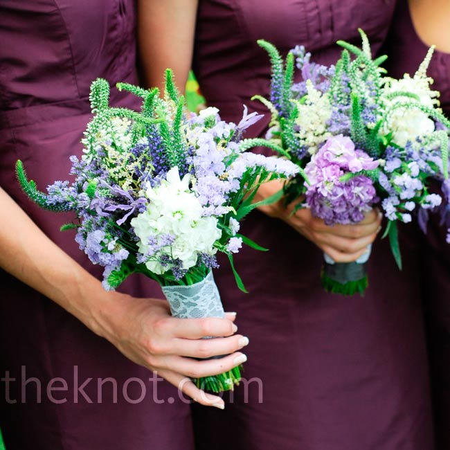 White and purple stock, lavender, statice, caspia, Veronica and astilbe were hand-tied together with purple satin ribbon and a white lace overlay.
