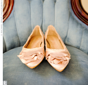 Satin Pedro Garcia flats in a soft taupe color with ruffles on each toe completed Adrienne's look.