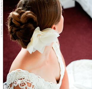 Instead of a veil, the bride tucked a layered, fabric flower into her vintage updo.