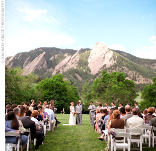 The couple exchanged vows in Chautauqua Park while facing the Flatirons.