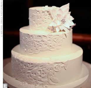A swatch of the bride's gown was used as a blueprint for the lace fondant on the ivory buttercream wedding cake.