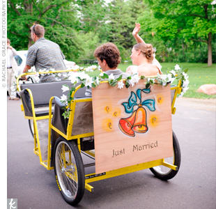 "The bride and groom were whisked away in a pedicab with a ""Just Married"" sign made by one of their friends."