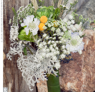 """Simple and organic"" was how the bride described thistle, Dusty Miller, white wax flowers, wheat grass and scabiosa in her bouquet."