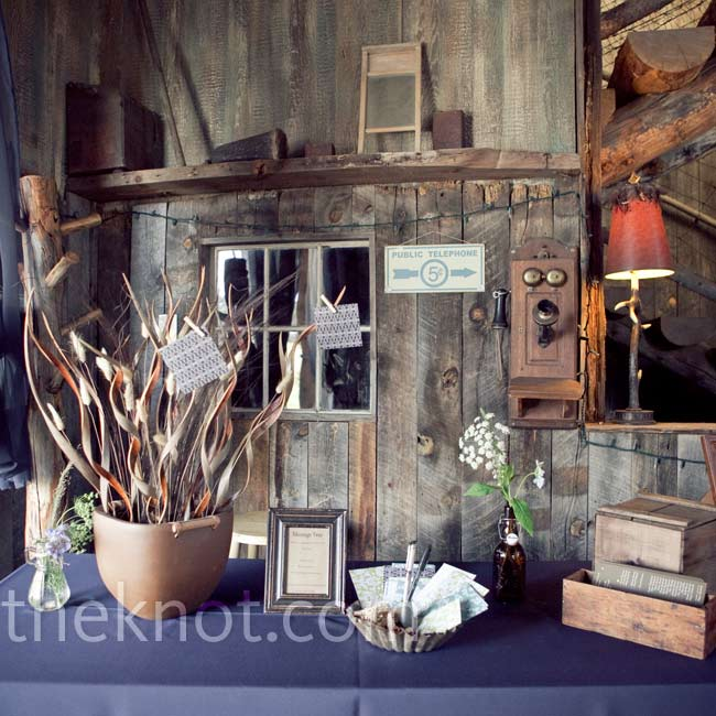 In lieu of a traditional guest book, guests wrote down their wishes on cards and pinned them to curly branches displayed in a decorative vase.