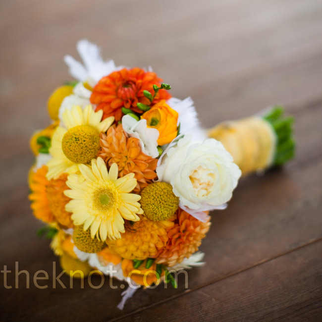 Holly loves craspedia and knew the little yellow balls would look great in her tightly bundled bouquet with mini gerbera daisies, dahlias, garden roses and ranunculus.