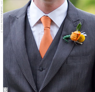 Seth matched his bride's bouquet with a single craspedia and an orange ranunculus.