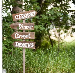 Fitting in nicely with the rustic surroundings, a row of hand-painted signs directed guests toward the ceremony, reception space and entertainment.