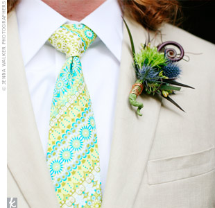 The couple loved the artistic boutonnieres constructed with blue thistle, various greenery and fiddlehead fern.