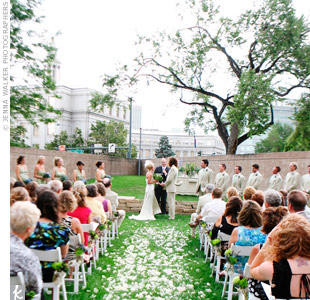 Julia and Jacob exchanged vows on the museum&#39;s lush green space overlooking downtown Denver.
