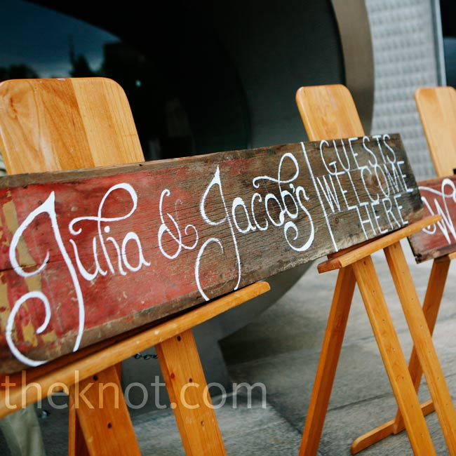 Weathered wood signs directed guests to the museum's outdoor green space for Julia and Jacob's ceremony.