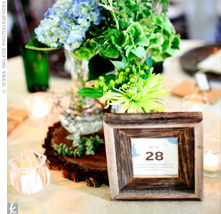 Clusters of vintage vases filled with thistle, wildflowers and succulents sat atop slices of tree trunk.