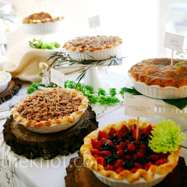 Instead of traditional cake, Julia and Jacob served a variety of pies displayed on slices of tree trunk to match the centerpiece displays.