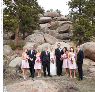 The bridesmaids&#39; rose-colored dresses matched the pink ties that accented the guys&#39; classic black suits.