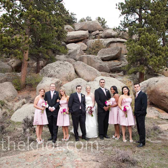 The bridesmaids' rose-colored dresses matched the pink ties that accented the guys' classic black suits.