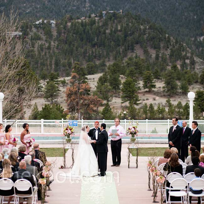 Kirsten and Bobby exchanged vows in front of the Stanley Hotel, with the picturesque Rocky Mountains as their backdrop.