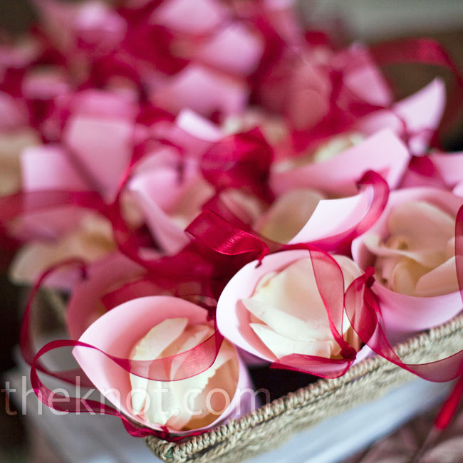 Guests grabbed paper cones filled with rose petals to shower the couple after they exchanged vows.