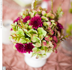 Kirsten wanted centerpieces that made an impression without overwhelming the space. Small arrangements of green hydrangeas interspersed with pink blooms were just what she had in mind.