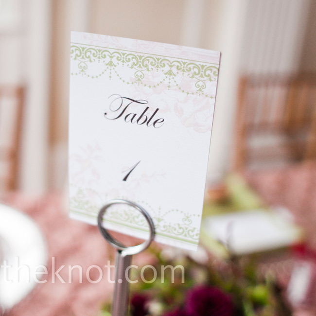 Elegant numbers printed on pink and green cardstock with vintage graphics helped guests find their tables.