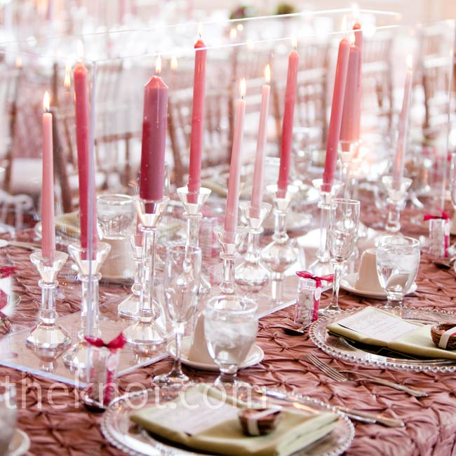 The room wasn't equipped for extra lighting or wattage, so the couple used lots of candlesticks in crystal holders to give tables a romantic, ambient glow.