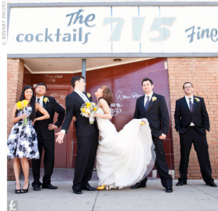 The groomsmen wore charcoal, silver and black graphic screen-printed ties to complement the groom's light silver screen-printed tie. Ellen's maid of honor matched with a gray and white flower-print gown.