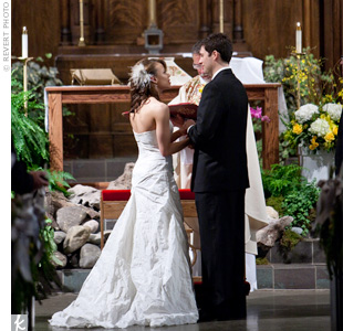 The couple exchanged vows in the bride's family church -- one of the oldest cathedrals in Denver -- with beautiful stained glass and magnificent woodwork.