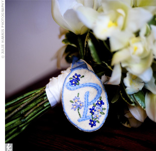 "The maid of honor gave Lauren an embroidered ""P"" surrounded in forget-me-not flowers, as a touching reminder of her late brother, Paul."