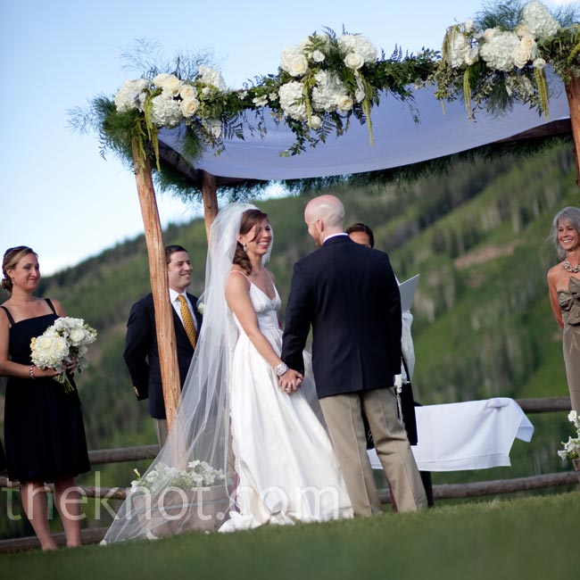 Guests rode the gondola up to the wedding site where the bride and groom were married under an Aspen log huppah draped in white fabric and overflowing with flowers.