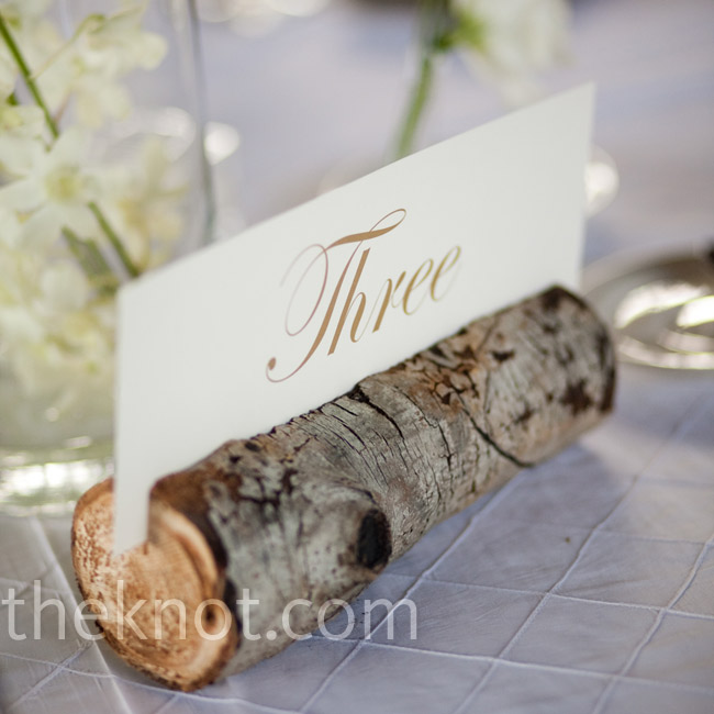 The couple displayed their table numbers in log holders, made from local Aspen trees.