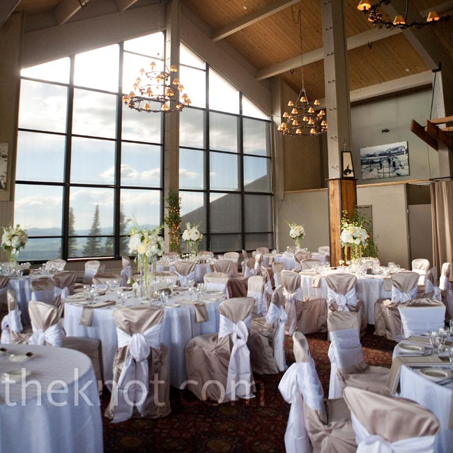 The neutral colored linens and white centerpieces complemented the spectacular views of the mountains outside of the Champagne Powder Room.