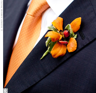 Keeping with the color scheme, the guys wore orange blooms on their lapels.