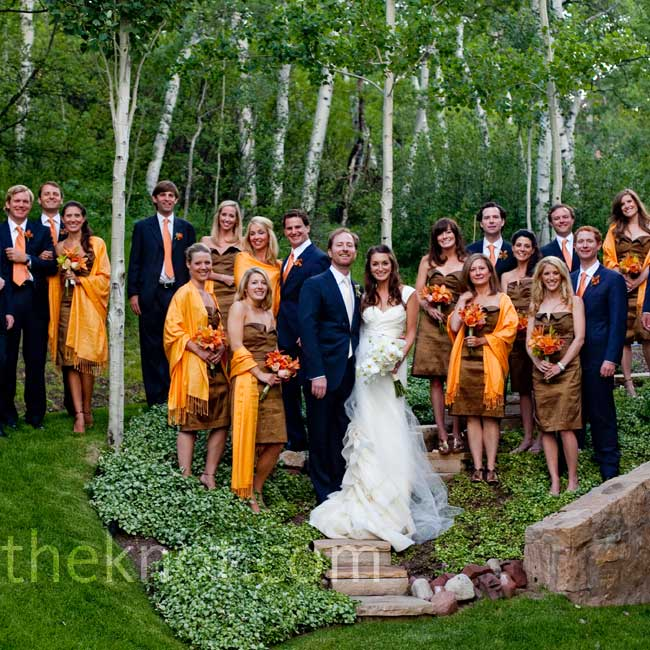 Amanda's 11 bridesmaids wore tangerine-colored wraps with their bronze dresses.