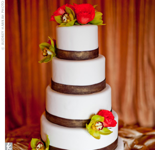 Green orchids and orange roses adorned the five-tiered cake.