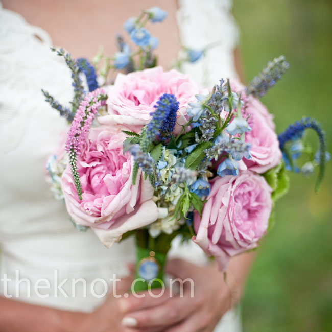 Laura carried plump, pink garden roses, Veronica, delphinium and lisianthus in her bouquet -- a style mimicked in the other wedding flowers.