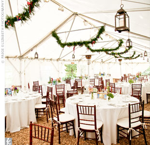 Swags of evergreen and flowers hung from the tent with lots of lanterns and twinkling lights.