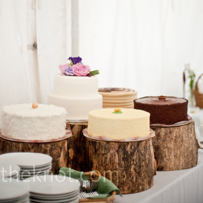 The groom's father sliced the pieces of tree trunk that were used to display cakes in tasty flavors like lemon curd and chocolate with salted caramel.